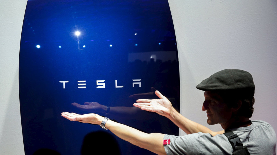Attendees take pictures of the new Tesla Energy Powerwall Home Battery during an event at Tesla Motors in Hawthorne, California April 30, 2015. Tesla Motors Inc unveiled Tesla Energy - a suite of batteries for homes, businesses and utilities - a highly-anticipated plan to expand its business beyond electric vehicles. REUTERS/Patrick T. Fallon